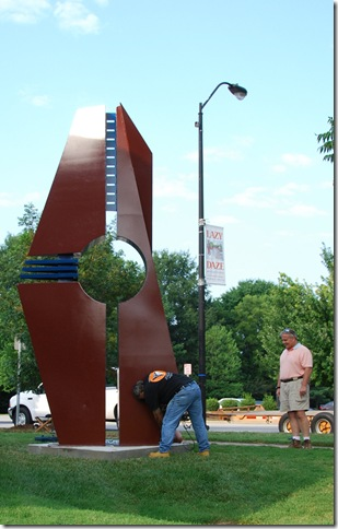 "Hanna Jubran installs ""Earth, Water, Wind, Fire #2"" as Ken Jarvis looks on.  photo by Kim Marchesseault"